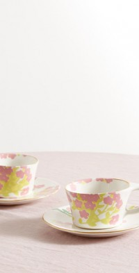 Set of two gold-plated ceramic cups and saucers
